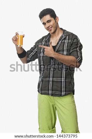 Man pointing at a glass of juice