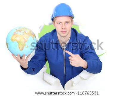 Man pointing at globe - stock photo