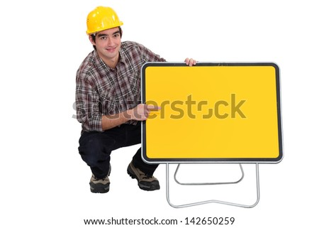 Man pointing at traffic sign - stock photo