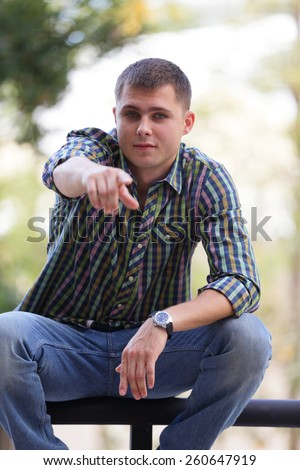 Man pointing his finger at the camera - stock photo