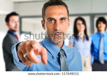Man pointing his finger at you - stock photo
