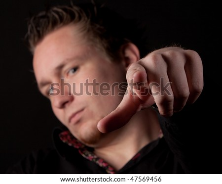 Man pointing his finger at you isolated on black