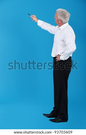Man pointing to an invisible object - stock photo