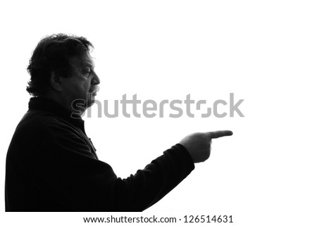 man points a finger in front of him - stock photo
