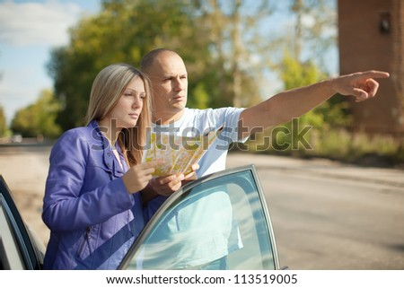 man points the direction at the road - stock photo