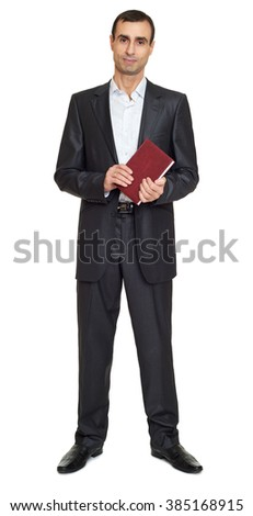 Man portrait in black suit with book on white at studio - stock photo