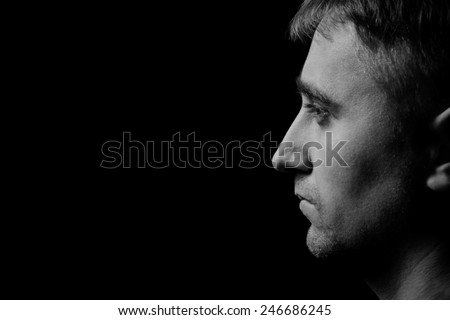 man portrait in low key - stock photo