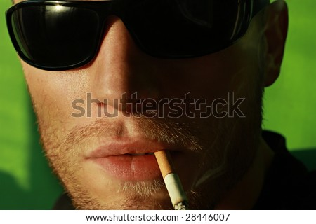 Man portrait with eyeglasses smoking - stock photo