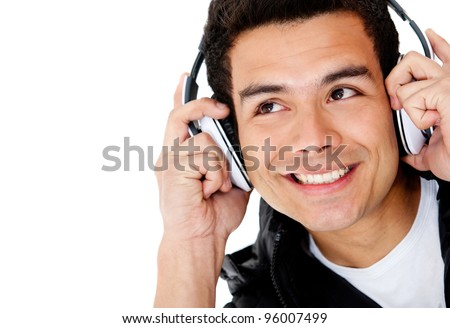 Man portrait with headphones listening to music - isolated over a white background - stock photo