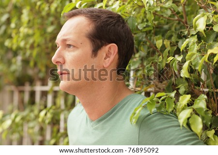 Man posing by a nature setting - stock photo