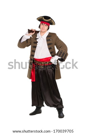 Man posing in pirate costume with a pistol. Isolated on white