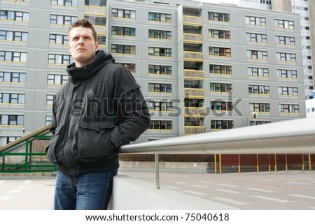Man posing in suburban - stock photo