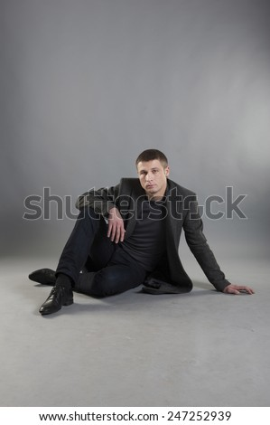 Man posing on gray background - stock photo
