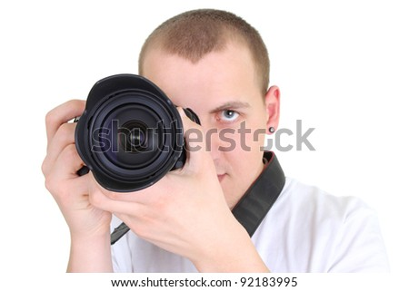 man posing with a photographic camera  over white