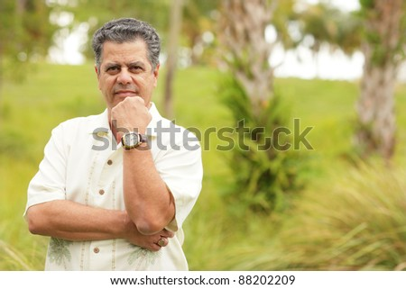 Man posing with hand under chin