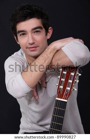 Man posing with his guitar - stock photo