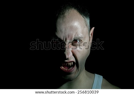 man possessed by demon - stock photo