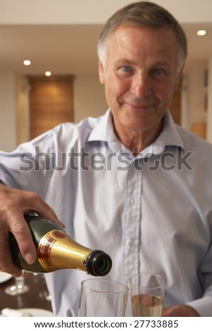 Man Pouring A Glass Of Champagne