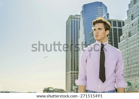 Man Power. Young blonde, handsome businessman, wearing long sleeve, pink shirt, necktie, standing in the front of busy business district, confidently looking forward. Instagram filtered effect. - stock photo