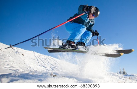 Man practicing extreme ski on sunny day - stock photo