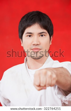 man practicing karate - stock photo