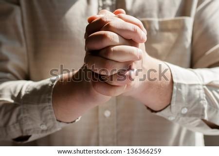 man praying - stock photo