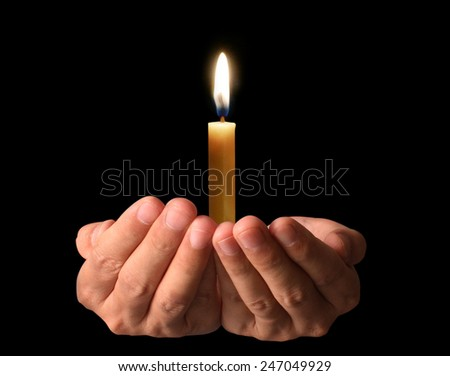 Man Praying Hands with candle - stock photo