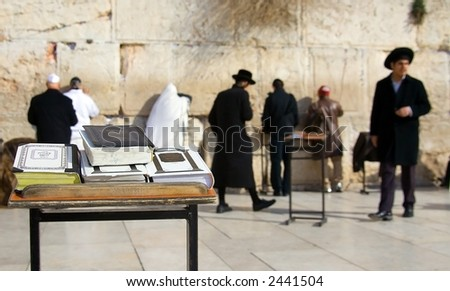Man praying in front of the Wailing Wall in Jerusalem, Israel - stock photo
