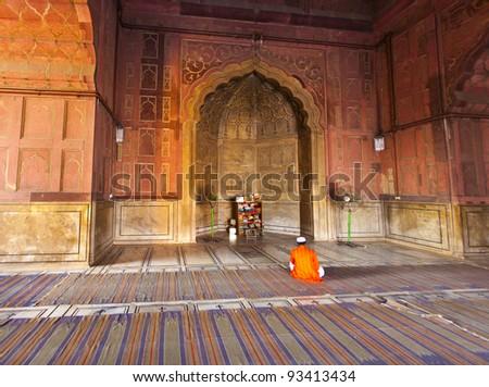 man praying in the Jama Masjid Mosque in Delhi - stock photo