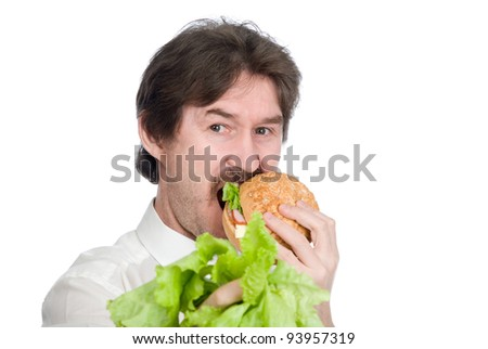 Man prefers hamburger instead of salad. Isolated on white background