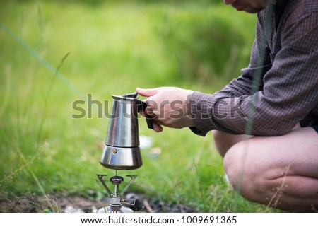man preparing coffee at a picnic, Ukraine, city of Chernigov, June 2017  editorial