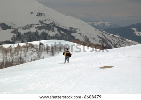 Man preparing for recreation in snow.