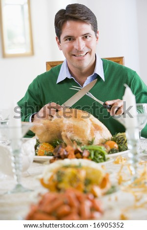 Man Preparing To Carve A Turkey - stock photo