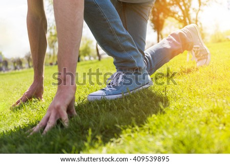 Man preparing to run, startup concept - stock photo