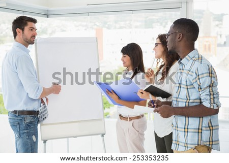 Man presenting and coworkers taking notes in the office - stock photo