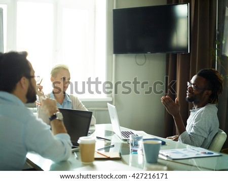 Man presenting his ideas at meeting - stock photo