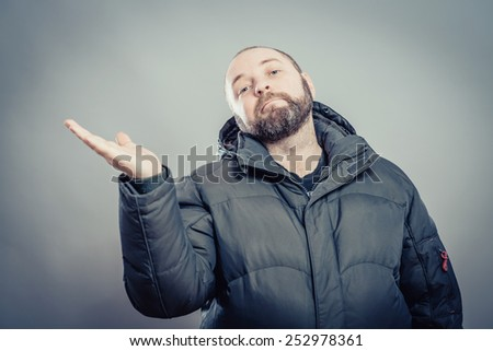 Man presenting something on hand. You may add your text or product for offering ora showing a sharing concept - stock photo