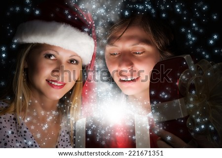 Man presenting to woman red gift box - stock photo