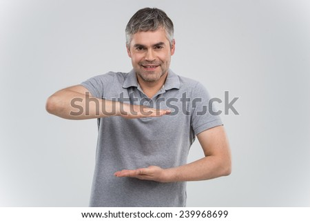 man presenting your product isolated over white background. adult guy making frame using hands - stock photo