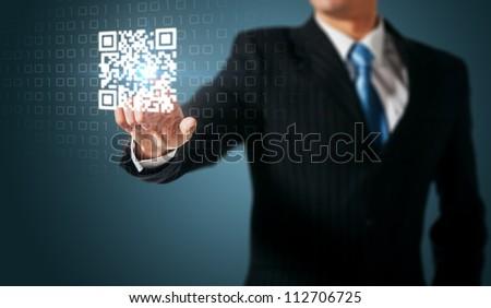 Man press on QR code - stock photo