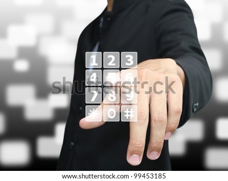 Man press phone number - stock photo