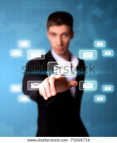 Man pressing email icon, futuristic technology - stock photo