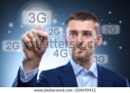 man pressing 3g touchscreen button - stock photo