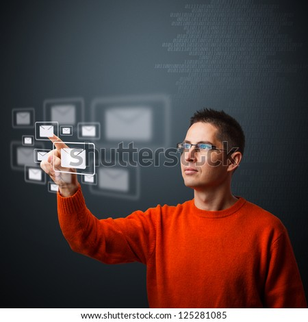 Man pressing mail symbol on digital interface - stock photo