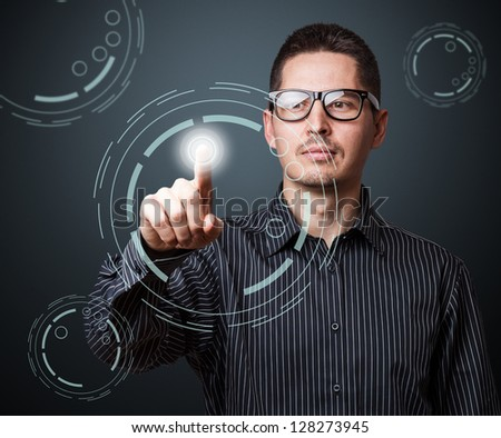 Man pressing modern touch screen buttons - stock photo