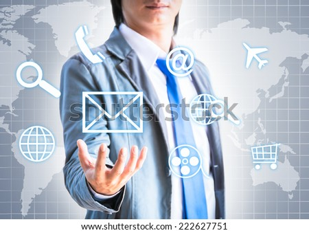 Man pressing modern touch screen buttons with a grey technology background  - stock photo