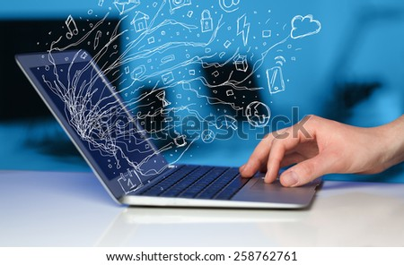 Man pressing notebook laptop computer with doodle icon media cloud symbols  - stock photo