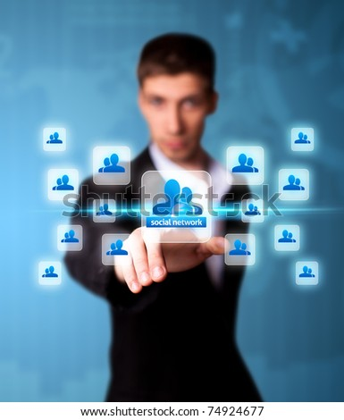 Man pressing social network icon, futuristic technology - stock photo