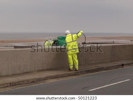 Man pressure washing a wall - stock photo