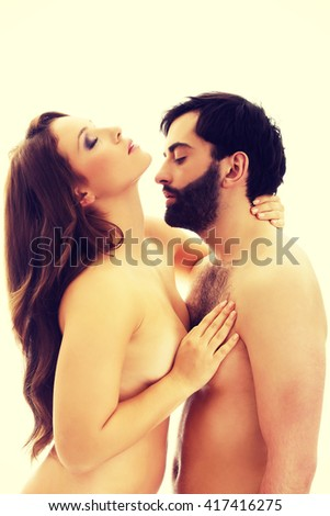 Man pretending to kiss woman's neck. - stock photo